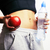 woman measuring waist with red apple and water african tann iso stock photo © iordani