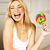 young pretty blonde girl with colorful candy happy smiling emotional posing lifestyle people conce stock photo © iordani