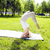blonde real girl doing yoga in green park gymnastic head over h stock photo © iordani
