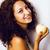 młodych · szczęśliwy · uśmiechnięty · piękna · kobieta · jabłko · kręcone · włosy - zdjęcia stock © iordani