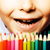 little cute boy with color pencils close up smiling education f stock photo © iordani