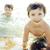 boldog · gyerek · ugrik · tengerpart · nyári · vakáció · ünnep - stock fotó © iordani