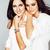 feliz · jovem · irmãs · posando - foto stock © iordani