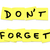 dont forget reminder words on yellow sticky notes stock photo © iqoncept