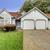 house with large arch window and three car garage stock photo © iriana88w