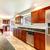Large bright kitchen with dark cherry cabinets. foto stock © iriana88w