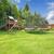 Play kinds ground area with tremplin in fenced backyard. stock photo © iriana88w