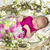 baby girl in pink inside of basket with spring flowers stock photo © iriana88w