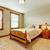 Natural farm house bedroom  with beige carpet and green walls. stock photo © iriana88w