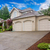 large beige house with three car garage and large driveway stock fotó © iriana88w