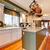 Large white and green kitchen with hardwood floor. stock photo © iriana88w