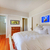 bedroom with white bed and cherry hardwood floor stock photo © iriana88w