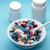 dois · branco · médico · pílulas · isolado · medicina - foto stock © ironstealth