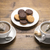 set of two ceramic tea mugs with sachet and plates cookies stock photo © ironstealth