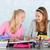 two teen girls making homework together stock photo © ivonnewierink