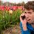 Épouvantable · coup · de · téléphone · homme · fleur · champs - photo stock © ivonnewierink