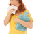 red haired woman blowing nose with hot water bottle stock photo © ivonnewierink