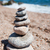 beach with stacked stones stock photo © ivonnewierink
