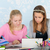 two teen girls making homework together with digital tablet stock photo © ivonnewierink