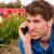 positif · coup · de · téléphone · homme · fleur · champs - photo stock © ivonnewierink