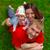 mutlu · aile · mutlu · güzel · genç · aile · yeşil · ot - stok fotoğraf © ivz