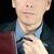 worried businessman adjusts tie stock photo © jackethead