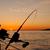 para · baixo · vara · de · pesca · pôr · do · sol · costa · Vancouver - foto stock © jameswheeler