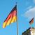 zászlók · híres · Berlin · égbolt · épület · kék - stock fotó © janhetman
