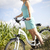Young woman riding a bicycle stock photo © JanPietruszka