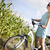 young woman riding bike summer free time spending stock photo © janpietruszka
