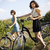 woman riding bicycle summer free time spending stock photo © janpietruszka