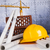 crane safety helmet blueprints and construction site stock photo © janpietruszka