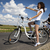 young woman riding bike summer free time spending stock photo © janpietruszka