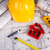 hard hat with blueprints and rulers stock photo © janpietruszka