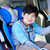 handsome disabled six year old boy smiling in carseat stock photo © jarenwicklund