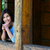 jovem · varanda · sorridente · sessão · olhando - foto stock © jarenwicklund