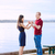 young interracial couple holding hands standing on dock over lak stock photo © jarenwicklund