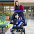 teenage girl pushing little disabled boy in wheelchair stock photo © jarenwicklund