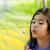 little girl blowing on a dandelion stock photo © jarenwicklund