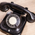 old black phone with dust and scratches on wooden floor stock photo © jarin13