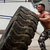 A muscular man participating in a cross fit workout by doing a tire flip stock photo © Jasminko