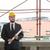 portrait of happy young foreman with hard hat stock photo © jasminko