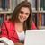 biblioteca · bastante · femenino · estudiante · portátil · libros - foto stock © jasminko
