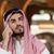 handsome middle eastern man talking on mobile phone stock photo © jasminko