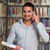 portret · gelukkig · mannelijke · student · bibliotheek · huiswerk - stockfoto © jasminko