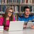 couple of students with laptop in library stock photo © jasminko