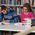 confused male student reading many books for exam stock photo © jasminko