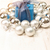perspective view of blue giftbox surrounded by silver baubles stock photo © jaycriss