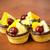 Closeup of four delicious fruit dessert tarts stock photo © jaycriss