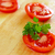 Fresh sliced tomato with water drops on it stock photo © jaycriss